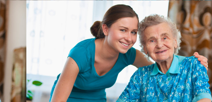 Happy caregiver and old woman