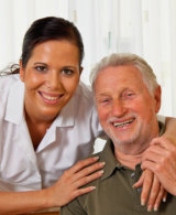 happy caregiver and old man